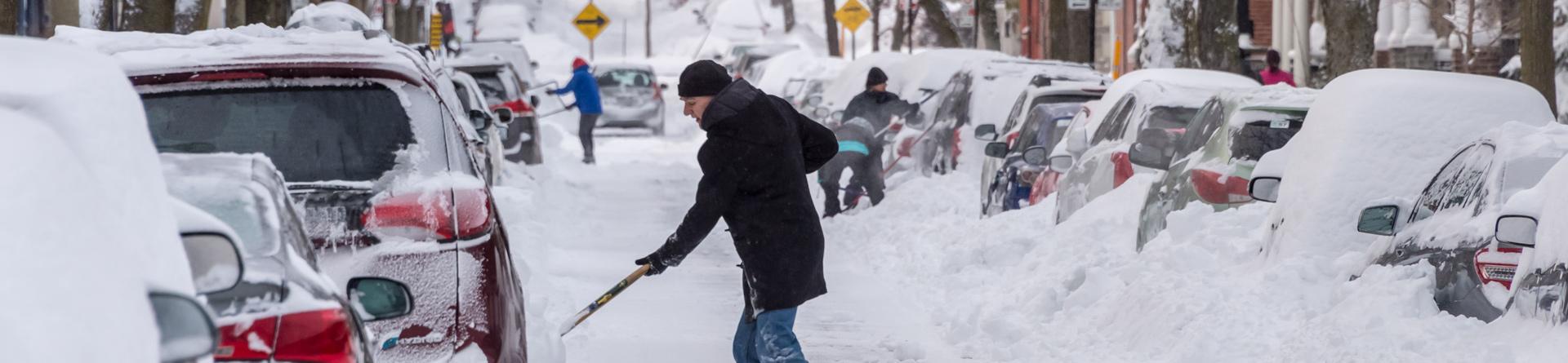 Man shoveling his driveway
