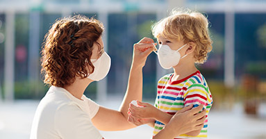 Mother and child wearing protective face masks
