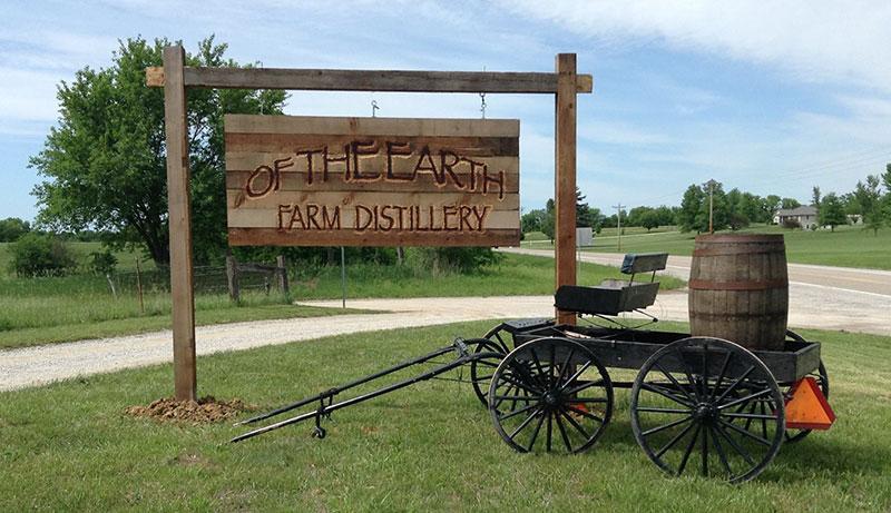 Of the Earth Farm Distillery sign