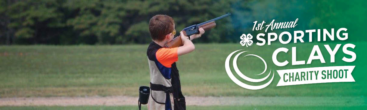 A young target shooter takes aim at his target.