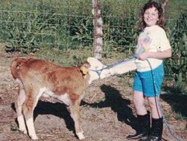 Katie Allen with her first bucket calf, Caitlyn