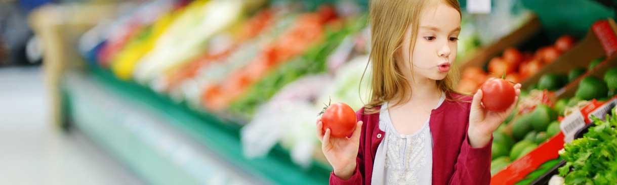 Girl selecting tomatoes
