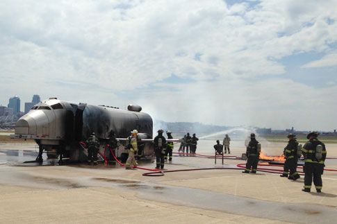 Firefighters extinguishing an aircraft fire on the tarmac