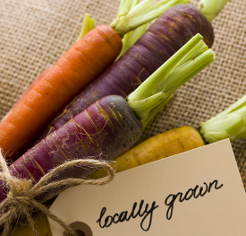 Fresh carrots with Locally Grown tag