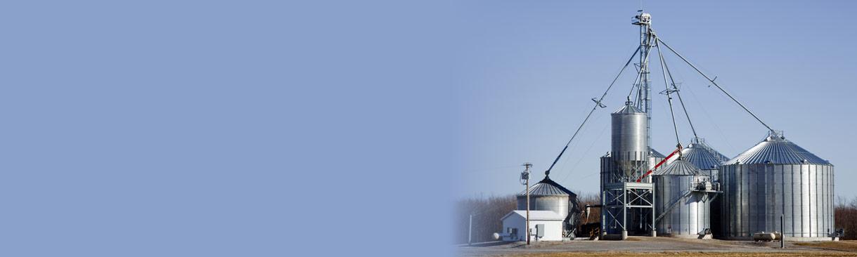 Grain storage facility against a blue sky