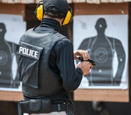 Police officer doing target practice
