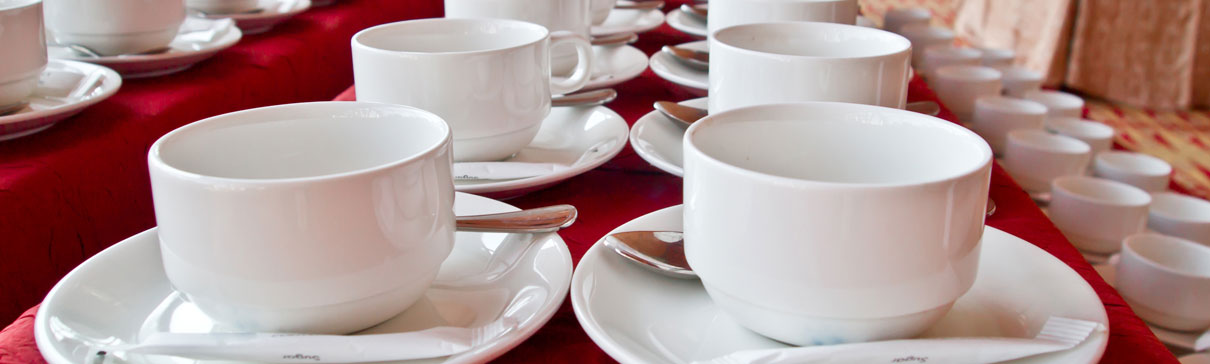 Coffee cups on a buffet table
