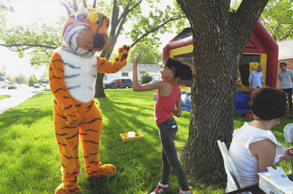 Truman giving high-five to girl at MU FIC event