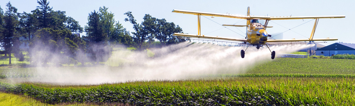 Crop duster spraying field