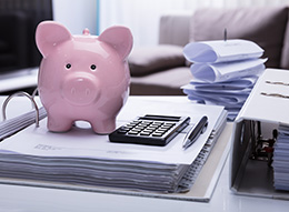 Piggy bank atop budgeting materials
